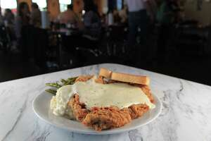 Perhaps no other dish represents Americans' desire for huge restaurant food portions than chicken fried steak, which often is large enough to fill a plate.