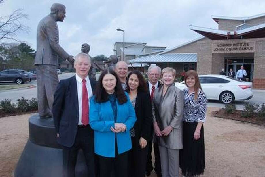 Dr. Marty Webb, second from right, attends the dedication of the Monarch School's larger campus in 2014.