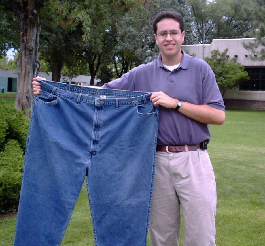 FILE - In this Aug. 7, 2001 file photo, Jared Fogle holds up a pair of jeans he used to wear after losing weight in Albuquerque, N.M. Subway benefited hugely from Fogle's weight loss story. Now the sandwich chain needs to figure out how to prevent him from overshadowing its future. (AP Photo/Ivan Chavez) Photo: Ivan Chavez, Associated Press