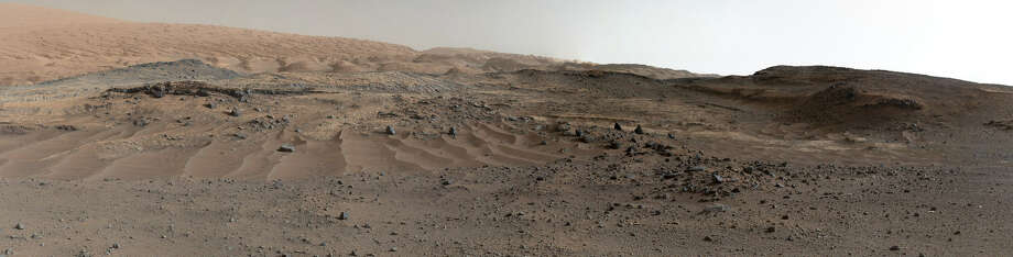 FULL WIDTH: Marking the anniversary, NASA released a massive Martian panorama, snapped by the rover Curiosity and its Mars Science Laboratory during its gradual ascent of the 18,000-foot-tall Mount Sharp—the ultimate destination of Curiosity's nearly seven-mile journey since landing on August 6, 2012. (NASA)Keep clicking for a closer look at the Martian landscape ...