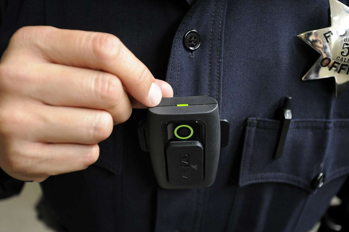 Officer Frank Bonifacio shows a green light on top that indicates the LE3 model Vievu body camera is recording, at OPD headquarters in Oakland, CA Wednesday, August 19, 2015.