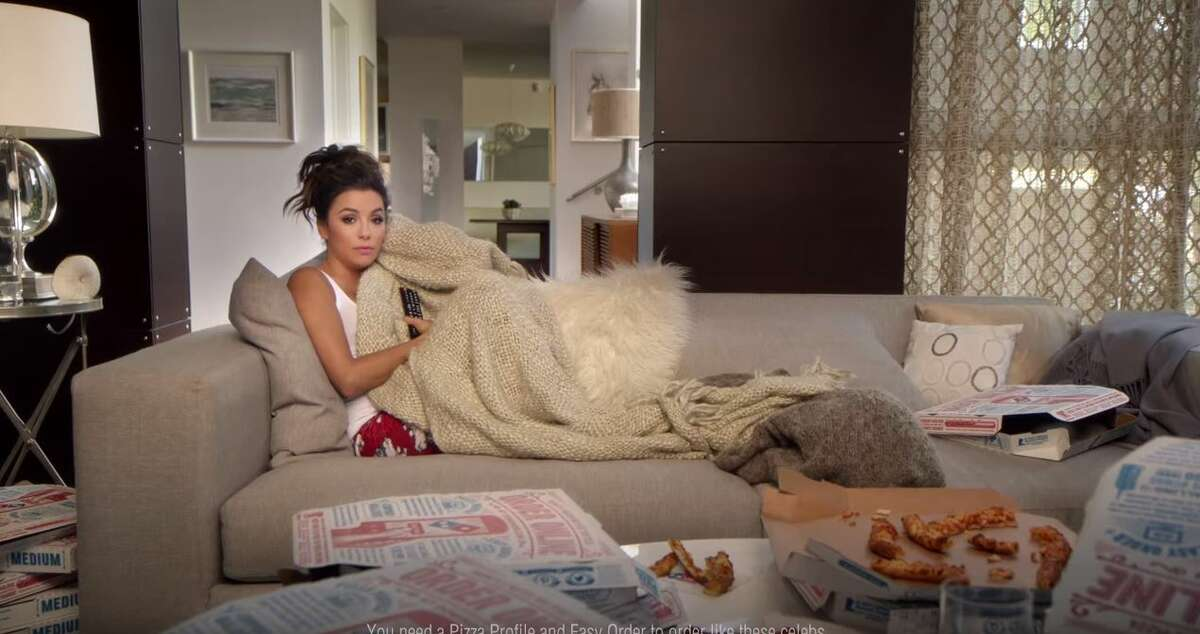 Eva Longoria is showing the nation how she orders pizza without ever leaving her sofa, from the thing that made her famous - a television.