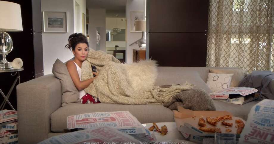 Eva Longoria is showing the nation how she orders pizza without ever leaving her sofa, from the thing that made her famous – a television. Photo: Mendoza,  Madalyn S, YouTube Screenshots