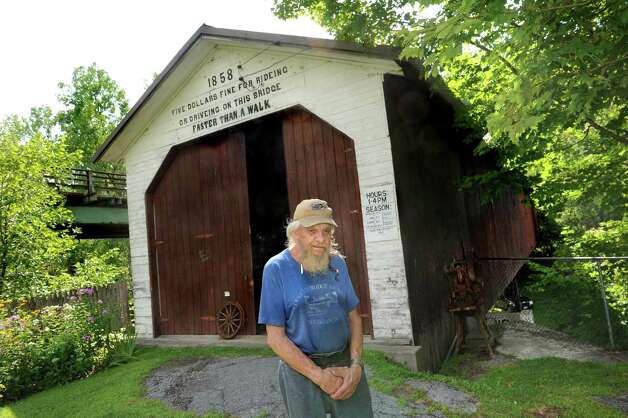 Assistant curator David McNitt at the entrance of the Shushan Covered Bridge Museum on Saturday, Aug. 15, 2015, in Shushan, N.Y. (Cindy Schultz / Times Union) Photo: Cindy Schultz / 00032996A