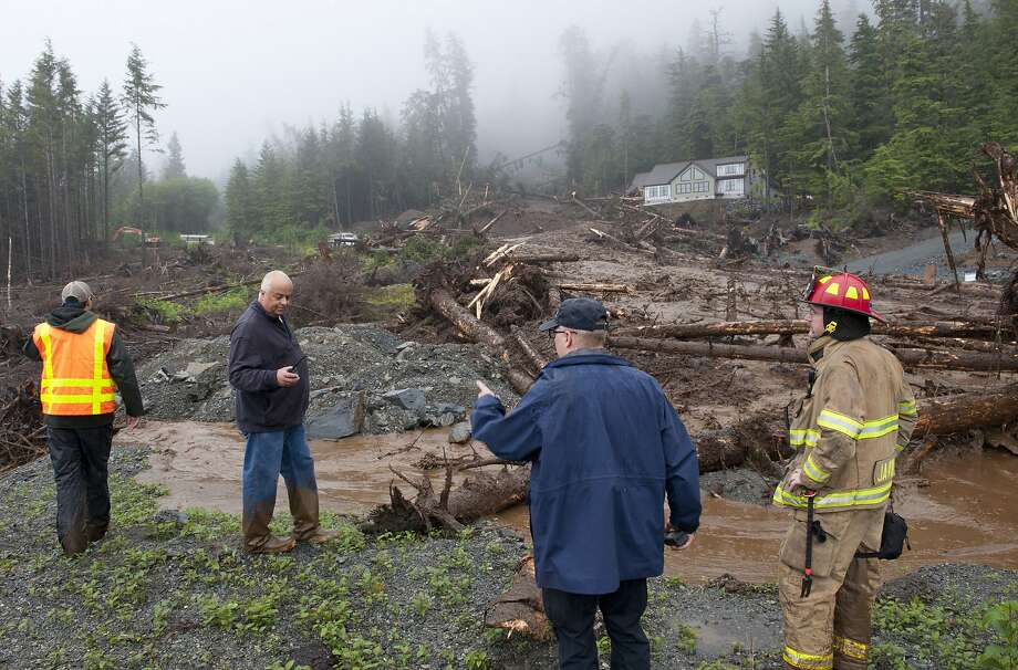 City officials survey the damage. Some residents are unable to reach or leave their homes. Photo: James Poulson, Associated Press