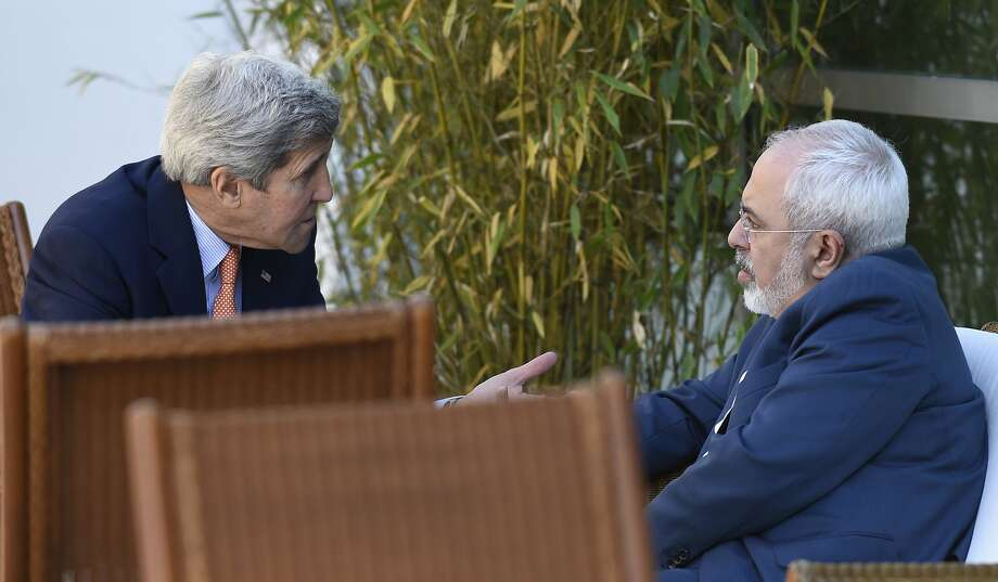 U.S. Secretary of State John Kerry talks with Iranian Foreign Minister Mohammad Javad Zarif in Geneva. Photo: Susan Walsh, Associated Press