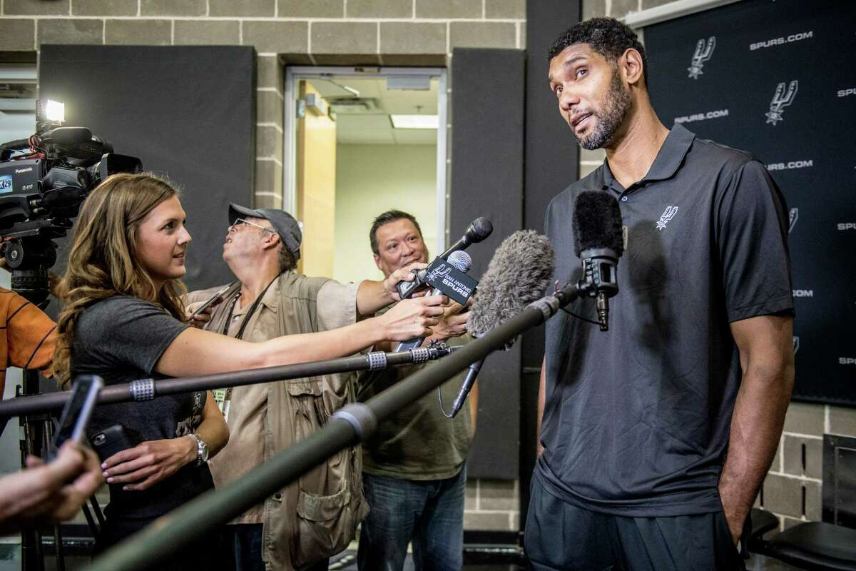Five-time NBA champion San Antonio Spur Tim Duncan answers questions by the media about being awarded the Twyman Stokes award for the 2014-15 season at the Spurs practice facility on Wednesday, August 19, 2015.