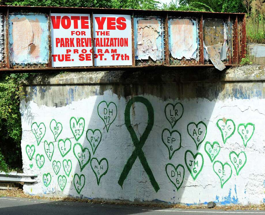 "A tribute to Sandy Hook on what is known as the ""graffiti bridge"" on Route 133 in Brookfield was recently painted over. Photo: Michael Duffy / Hearst Connecticut Media / The News-Times"