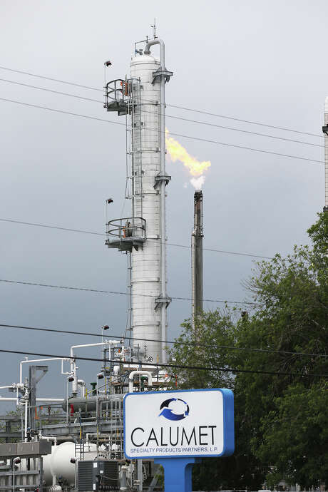 A flare from the Calumet Specialty Products Partners plant is seen near the Mission Reach of the San Antonio River in April 2014 when a second jet fuel spill happened. Photo: JERRY LARA /San Antonio Express-News / © 2014 San Antonio Express-News