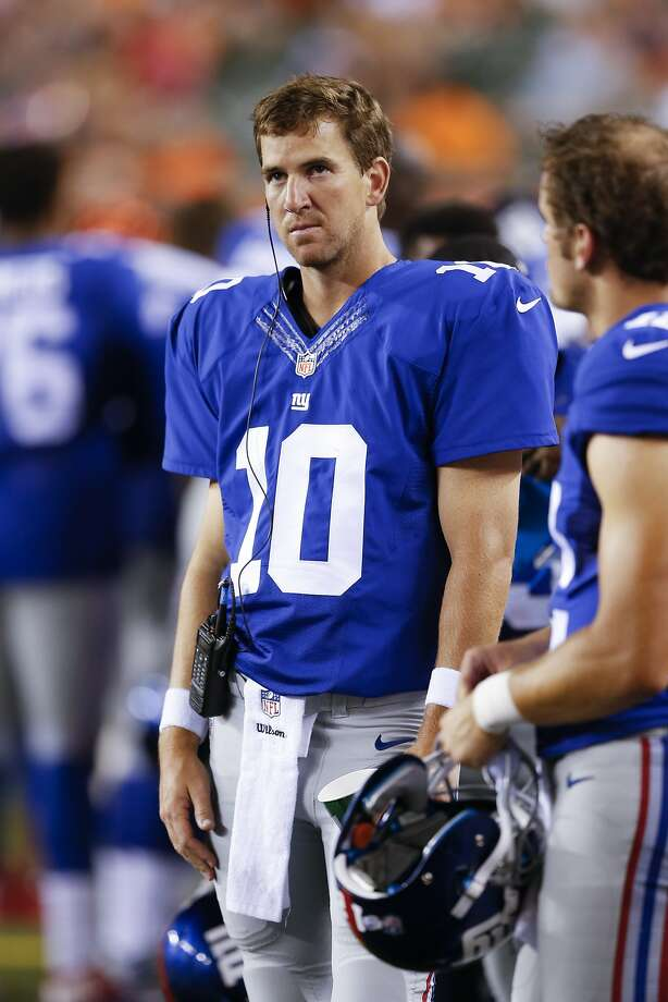 New York Giants quarterback Eli Manning stands on the sideline in the second half of an NFL preseason football game against the Cincinnati Bengals in Cincinnati, Friday, Aug. 14, 2015.  (AP Photo/Gary Landers) Photo: Gary Landers, Associated Press