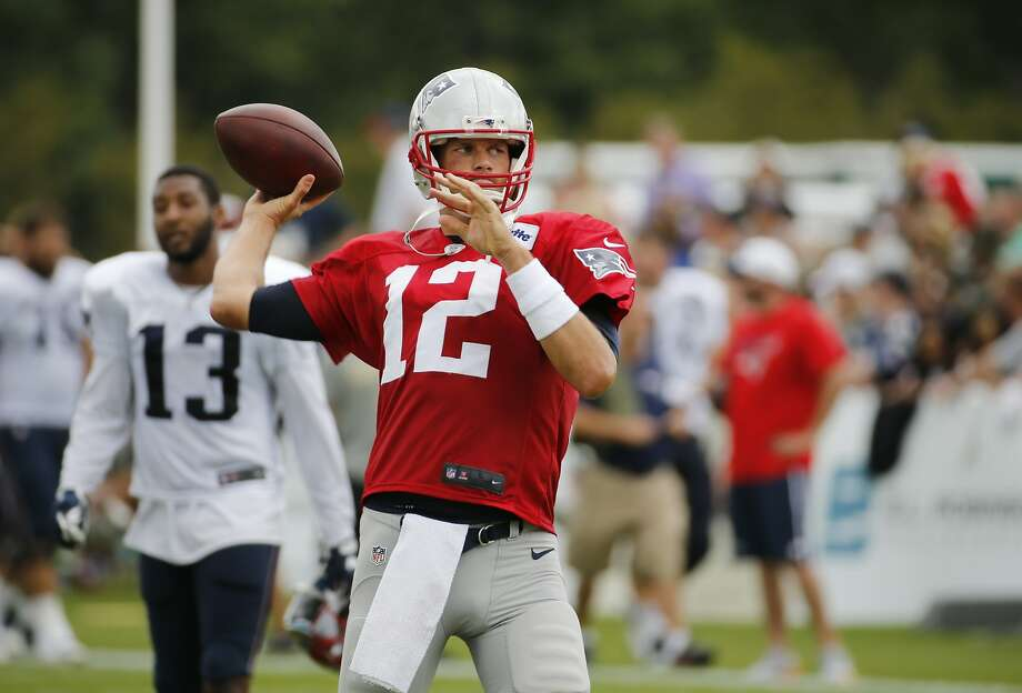 Patriots quarterback Tom Brady (12) warms up during a joint training camp session with the New Orleans Saints in White Sulphur Springs, W.Va. Photo: Steve Helber, Associated Press