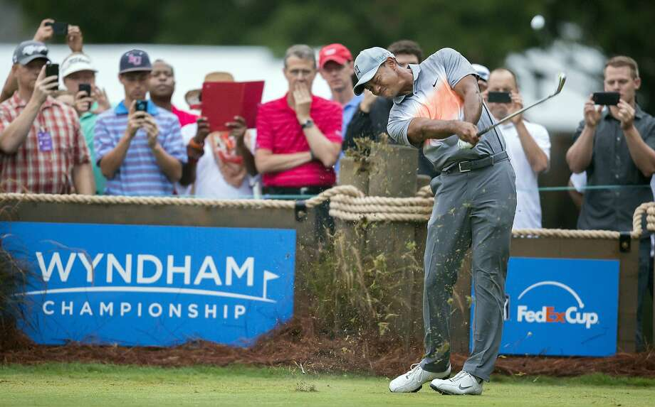 Tiger Woods tees off on the third hole during the pro-am at the Wyndham Championship golf tournament at Sedgefield Country Club in Greensboro, N.C. Photo: Rob Brown, Associated Press