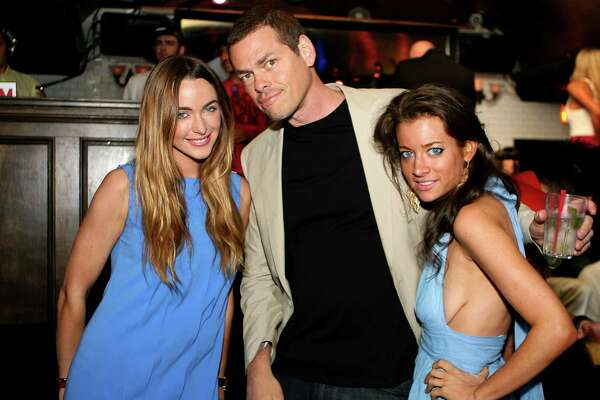 (C) ShamWow spoke person, Vince Offer with friends (L) Courtney Bingham, (R) Victoria Brook the after party for the screening of Anchor Bay Films' 'Spread' at Phillippe East Hampton at Lily Pond on August 8, 2009 in East Hampton, New York.