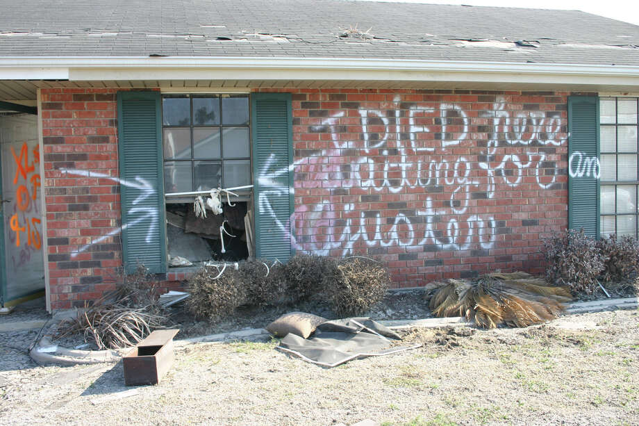 Photographs taken by Hurricane Katrina researcher Prof. Curtis Andrew show street art and other graffiti left in New Orleans' Lower Ninth Ward following the 2005 hurricane. Photo: Courtesy Curtis Andrew