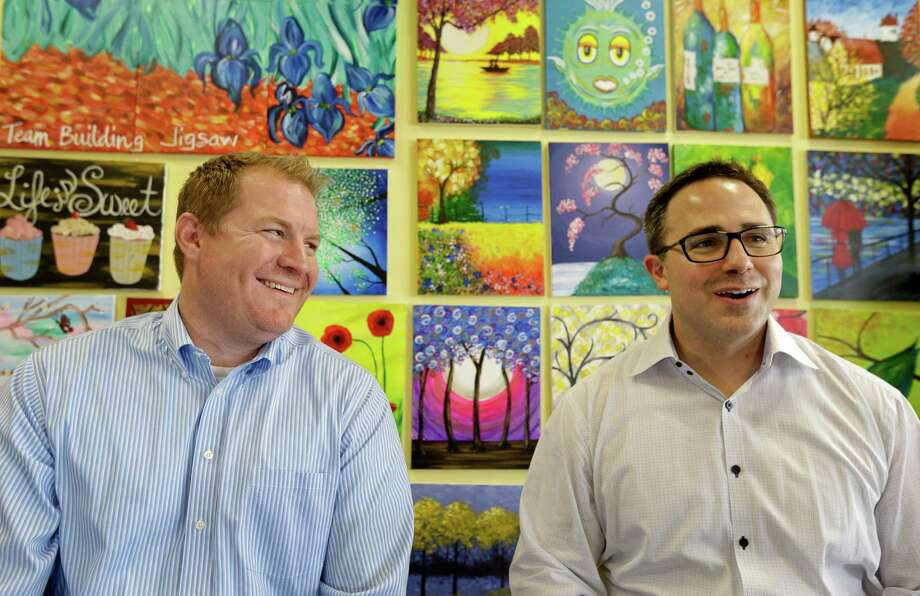 Pinot's Palette co-founders Charles Willis, left, president, and Craig Ceccanti, right, CEO, started a paint and sip business called Pinot's Palette. Here they are at their Memorial City area location. Both relocated to Houston from New Orleans due to Hurricane Katrina. Photo: Melissa Phillip, Houston Chronicle / © 2015 Houston Chronicle