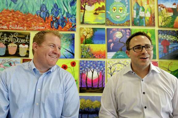 Pinot's Palette co-founders, Charles Willis, left, president, and Craig Ceccanti, right, CEO, share a laugh as they talk their lives and how they started a paint and sip business called Pinot's Palette, shown at their Memorial City area location at 12343 Kingsride Lane, Monday, Aug. 10, 2015, in Houston. Both relocated to Houston from New Orleans due to Hurricane Katrina.