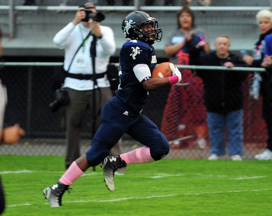 Ansonia's Tajik Bagley takes off for the endzone to score against Seymour, during football action in Ansonia, Conn., on Thursday Oct. 2, 2014. Photo: Christian Abraham / Hearst Connecticut Media / Connecticut Post