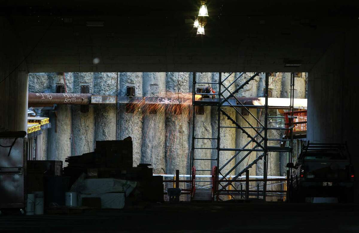 Sparks fly during construction in the southbound entrance of the Highway 99 tunnel during a tour of the north end of the Highway 99 tunnel in downtown Seattle. Photographed on Wednesday, August 19, 2015.