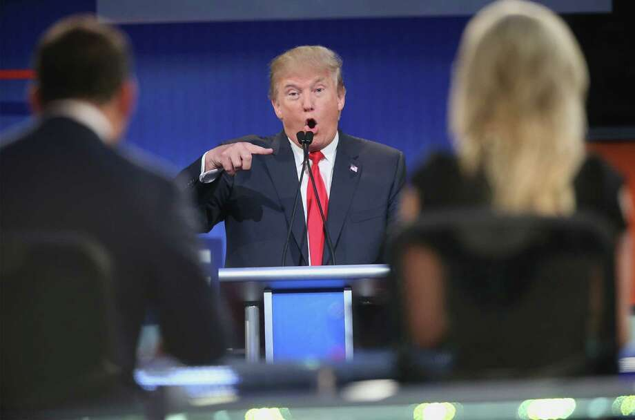 CLEVELAND, OH - AUGUST 06:  Republican presidential candidate Donald Trump fields a question during the first Republican presidential debate hosted by Fox News and Facebook at the Quicken Loans Arena on August 6, 2015 in Cleveland, Ohio. The top ten GOP candidates were selected to participate in the debate based on their rank in an average of the five most recent political polls.  (Photo by Scott Olson/Getty Images) *** BESTPIX *** Photo: Scott Olson, Staff / 2015 Getty Images