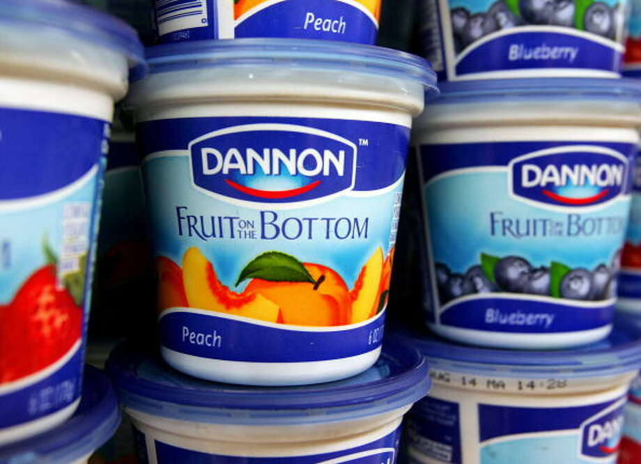 CENTREVILLE, UNITED STATES:  Dannon yogurt waits on a dairy shelve for customers at a grocery store 27 July, 2005, in Centreville, Virginia. Shares in Groupe Danone SA, the world's largest dairy products maker and the second largest bottled water producer, soared 26 July on continuing rumors of a possible bid by US based PepsiCo Inc. Shares in Danone rose, adding 3.3 percent to 84.50 euros, amid confusion about the intentions of the US soft drinks and snack maker. Rumors of a takeover of Danone by PepsiCo sparked an outcry last week, drawing angry comments from a host of senior political figures in France worried at the potential loss of a French corporate icon to a US company.   AFP PHOTO/Paul J. RICHARDS  (Photo credit should read PAUL J. RICHARDS/AFP/Getty Images) Photo: PAUL J. RICHARDS, AFP/Getty Images / 2005 AFP