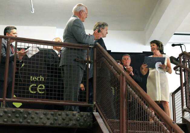Laban Coblentz, center, founder of the Tech Valley Center of Gravity is given a commendation by Rensselaer County Executive Kathleen M. Jimino, right,  during the opening of new Tech Valley Center of Gravity and incubator space at the historic Quackenbush Building on Wednesday Aug. 19, 2015 in Troy, N.Y.  (Michael P. Farrell/Times Union) Photo: Michael P. Farrell / 00032988A