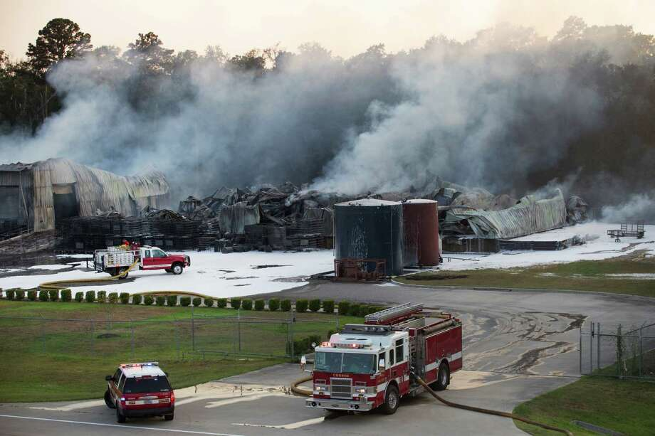 On Friday, firefighters work to contain the fire at DrillChem's warehouses in the 4100 block of South Loop 336. Investigators think electrical wiring or gas-power equipment may be to blame.  Photo: Brett Coomer, Staff / © 2015 Houston Chronicle