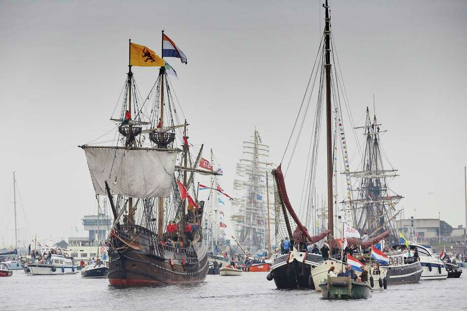 The replica of the Half Moon is among the tall ships escorted by small boats arriving in Amsterdam, the Netherlands, Wednesday, Aug. 19, 2015, to participate in SAIL Amsterdam 2015, a five-day festival celebrating the Dutch capital's maritime history which is expected to draw some 2 million visitors. The ninth edition of  the nautical event lasts until Sunday, Aug. 23 on and around the IJ river. (AP Photo/Phil Nijhuis) Photo: Phil Nijhuis / AP