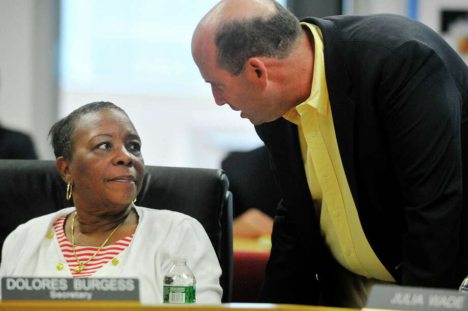 Dolores Burgess, left, has resigned from the Stamford Board of Education and moved from the city. She is shown here with board member Geoff Alswanger at what was her last full board meeting July 29. Photo: Jason Rearick / Hearst Connecticut Media / Stamford Advocate