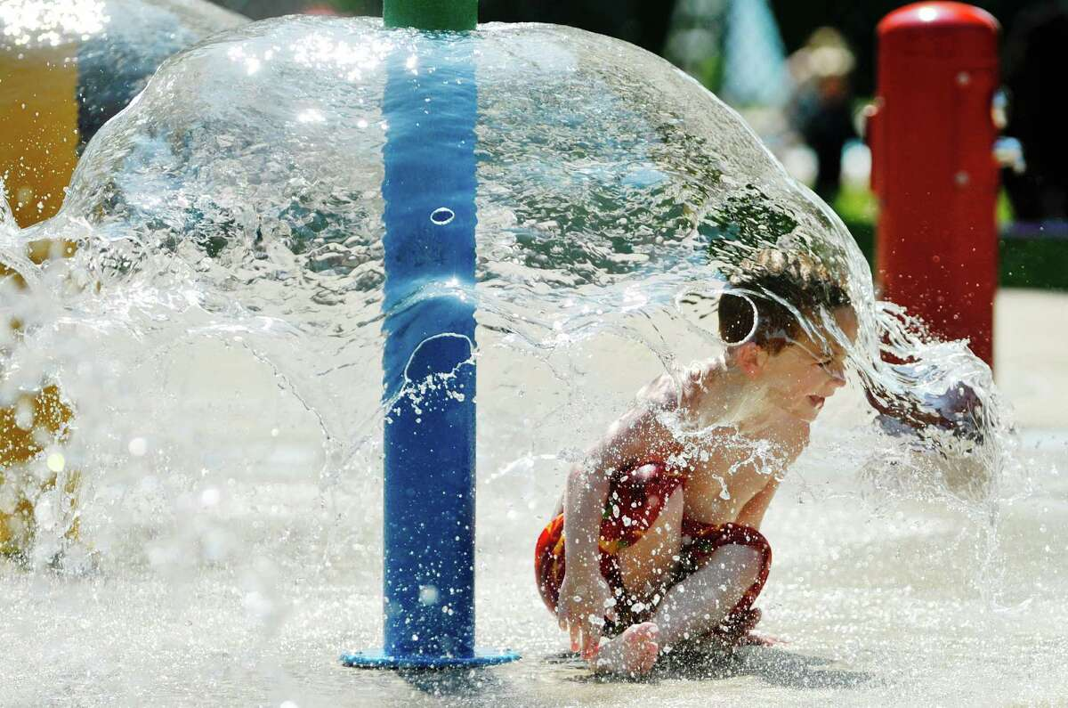 Matty J McKenna, 5, of Selkirk, plays in the spray pool at the Elm Avenue Park pool complex on Wednesday, Aug. 19, 2015, in Delmar, N.Y. The pool will not open in 2020 because of the pandemic. (Paul Buckowski / Times Union)