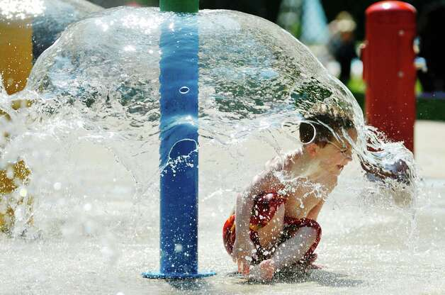 Matty J McKenna, 5, of Selkirk, plays in the spray pool at the Elm Avenue Park pool complex on Wednesday, Aug. 19, 2015, in Delmar, N.Y.  (Paul Buckowski / Times Union)