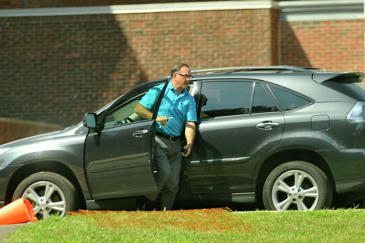 Al Barbarotta arrives as construction continues outside Stamford High School in Stamford, Conn., on Wednesday, Aug. 19, 2015.