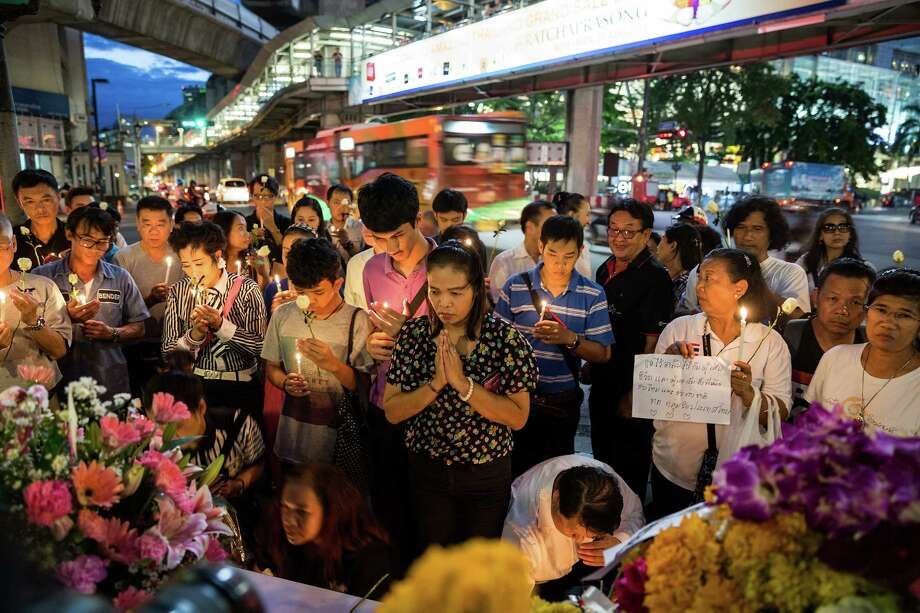 BANGKOK, THAILAND - AUGUST 19:  People pray in front the Erawan Shrine on August 19, 2015 in Bangkok, Thailand. On Monday evening Bangkok was hit by what has been described as Thailand's worst ever attack. Security across the country has been stepped up following the explosion which went off near a popular tourist site killing at least 20 people and injuring hundreds more.  (Photo by Nicolas Axelrod/Getty Images) Photo: Nicolas Axelrod, Stringer / Getty Images / 2015 Getty Images