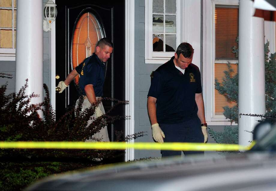 State Police investigate at the home of the son of a missing Easton couple on Aldine Avenue in Bridgeport. Photo: Christian Abraham / Hearst Connecticut Media / Connecticut Post