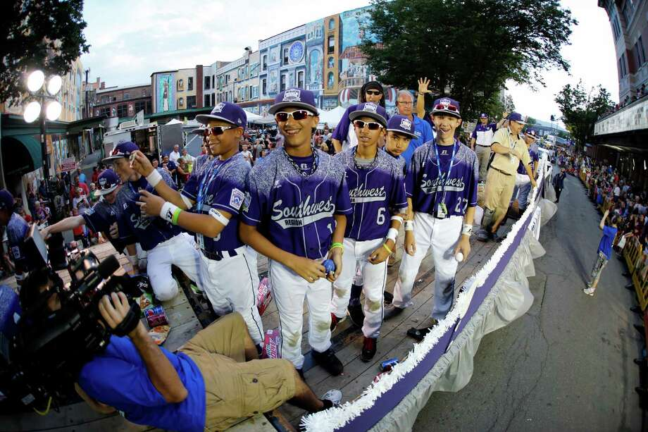 Members of the Little League team from Pearland West ride in the Grand Slam Parade in downtown Williamsport, Pa., Wednesday. The Little League World Series tournament starts Thursday. Photo: Gene J. Puskar, STF / AP