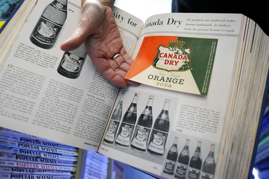Megan Prelinger displays a book of advertising logos at the library, which includes a wide array of cultural memorabilia. Photo: Michael Short, Special To The Chronicle