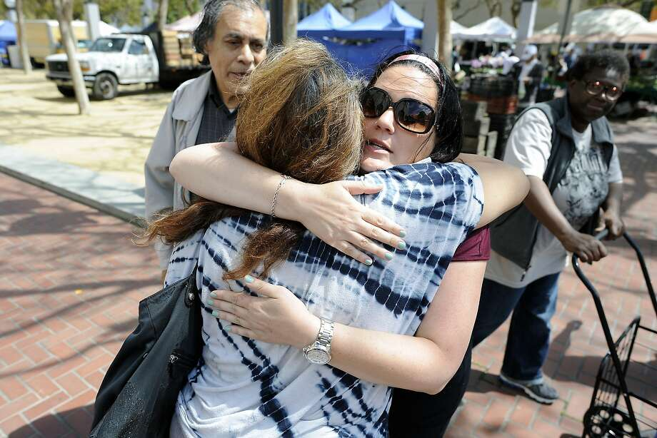 Samuel Merritt UniversityÕs School of Nursing student Amy Stevenson, right, gives a hug to Bishop Swing Community Housing resident Silvia Fuentes as they saw goodbye after shopping at the farmer's market at U.N. Plaza in San Francisco, CA Wednesday, August 19, 2015.  Samuel Merritt UniversityÕs School of Nursing students Amy Stevenson  and Jennifer Lee created a free five-week Òhealthy eatingÓ course for SRO residents that culminates in a field trip to the farmerÕs market in U.N. Plaza, where they give the residents $5 to buy as much food as they can and then show them how to cook it. Photo: Michael Short, Special To The Chronicle