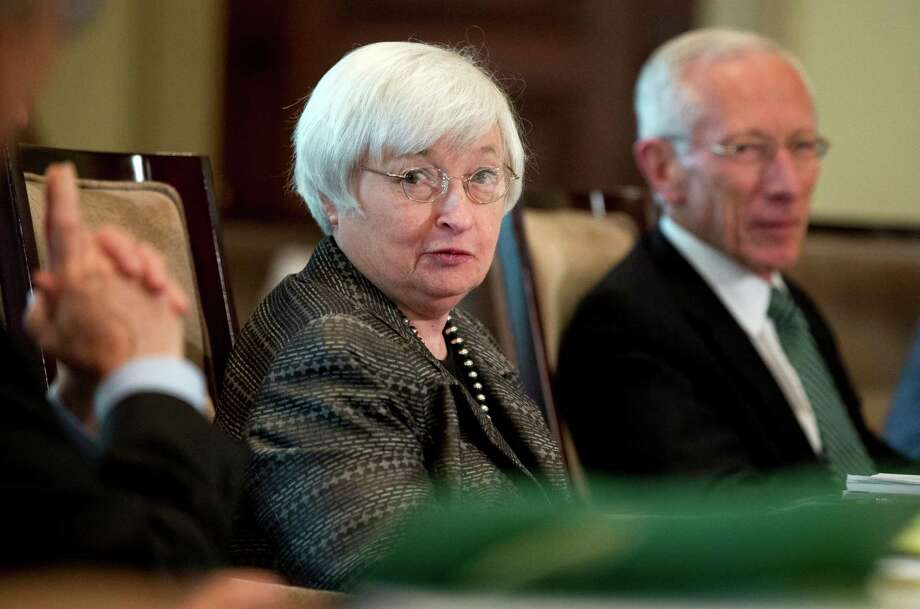 FILE - In this July 20, 2015, file photo, Federal Reserve Chair Janet Yellen, from left, with Vice Chairman Stanley Fischer, and the board of governors of the Federal Reserve System, presides over a meeting in Washington.  Photo: Manuel Balce Ceneta, STF / AP