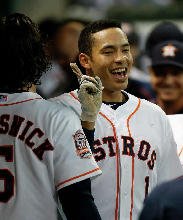 Houston Astros shortstop Carlos Correa (1) celebrates his solo home run with teammates in the dugout during the first inning of an MLB game at Minute Maid Park on Wednesday, Aug. 19, 2015, in Houston. Photo: Karen Warren, Houston Chronicle / © 2015 Houston Chronicle