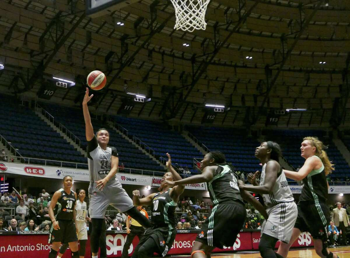 Kayla McBride of the San Antonio Stars shoots a hook shot against the New York Liberty during WNBA action at Freeman Coliseum on Wednesday, Aug. 19, 2015.
