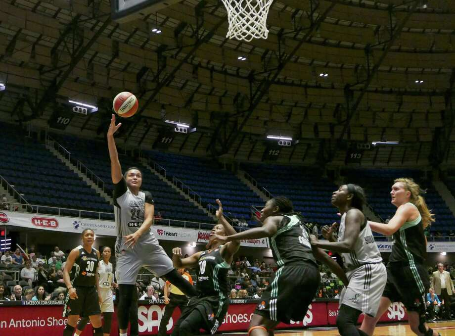 Kayla McBride of the San Antonio Stars shoots a hook shot against the New York Liberty during WNBA action at Freeman Coliseum on Wednesday, Aug. 19, 2015. Photo: Billy Calzada, Staff / San Antonio Express-News / San Antonio Express-News