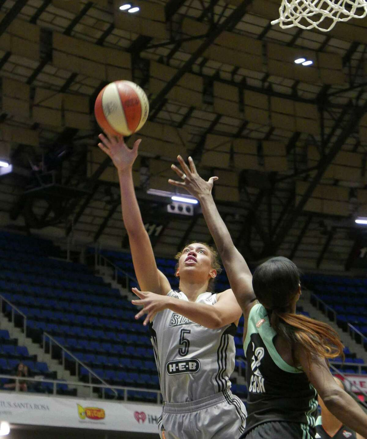 Dearica Hammy of the San Antonio Stars shoots over Swin Cash of the New York Liberty during first-half WNBA action at Freeman Coliseum on Wednesday, Aug. 19, 2015.