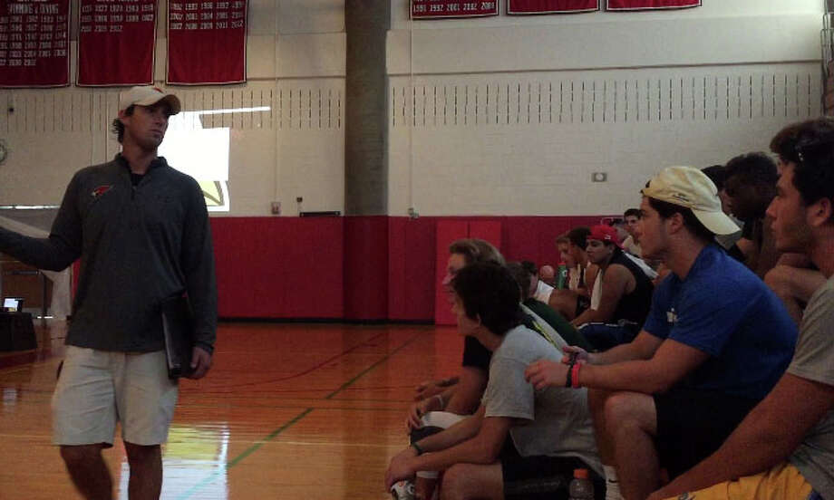 Greenwich High School head football coach John Marinelli addresses players during a YWCA presentation on domestic violence and sexual assault, in the high school's gymnasium, on Wednesday, Aug. 19, 2015. Photo: / Paul Schott