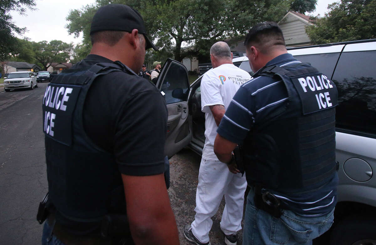 Immigration and Customs Enforcement (ICE) officers arrest a man Monday August 17, 2015 on San Antonio's Northwest Side. The agency was conducting a target enforcement operation to round up immigrants with warrants and outstanding deportation orders.