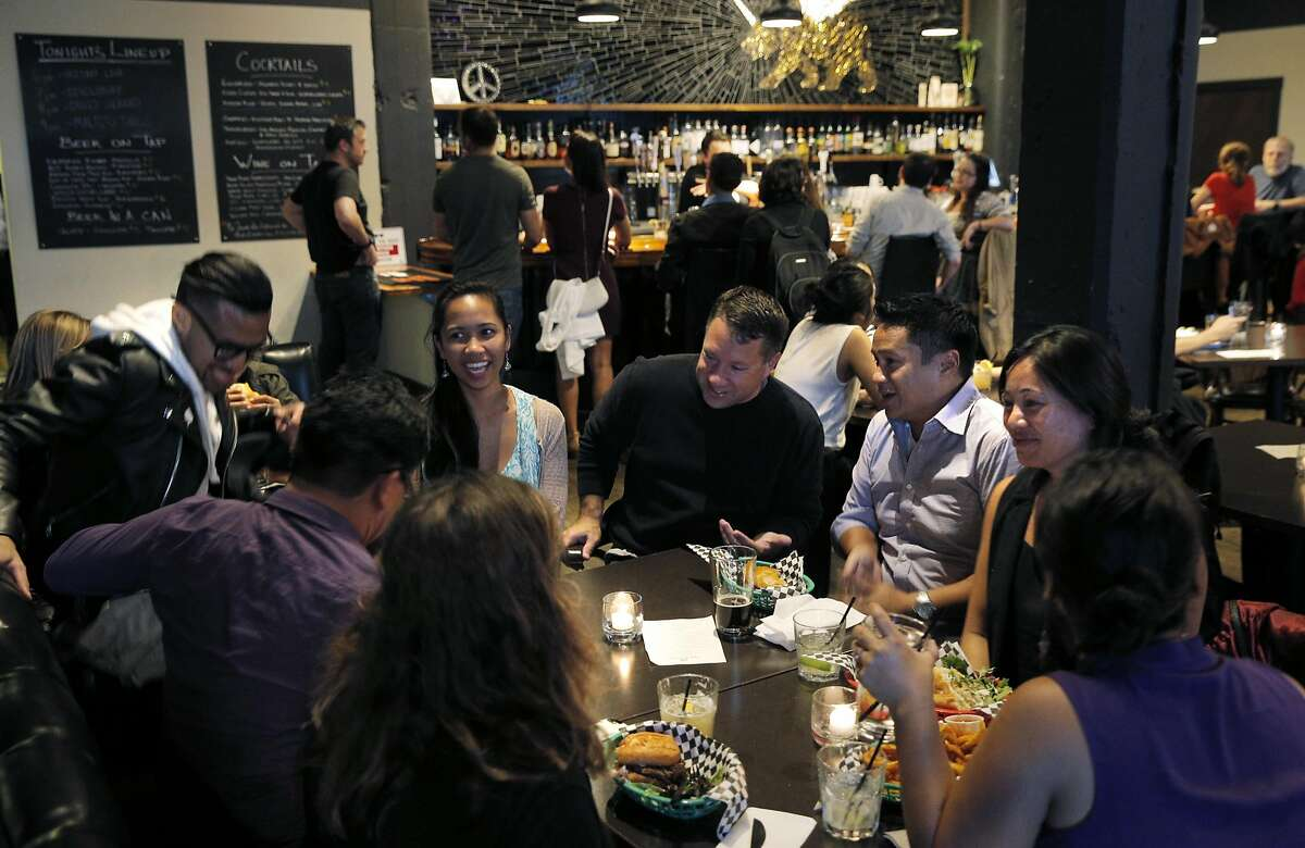Guests enjoy food and drinks at PianoFight, San Francisco's newest entertainment/food/bar space in the old Original Joe's space in the Tenderloin inSan Francisco, Calif., on Wednesday, August 19, 2015.