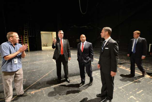 Speaker Carl Heastie is given a tour of Proctors Theater with Mayor Gary McCarthy, center left, and Assemblyman Angelo Santabarbara, center right, Wednesday, Aug. 19, 2015, in Schenectady, N.Y. Speaker Heastie also visited several other Schenectady County locations including General Electric Global Research Central Park and Mohawk Harbor. (Will Waldron/Times Union) Photo: WW