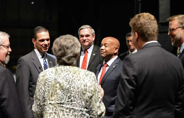 Speaker Carl Heastie, center right, is joined by Assemblyman Angelo Santabarbara, center left, Mayor Gary McCarthy, center, and others are given a tour of  Proctors Theater Wednesday, Aug. 19, 2015, in Schenectady, N.Y. Speaker Heastie also visited several other Schenectady County locations including General Electric Global Research Central Park and Mohawk Harbor. (Will Waldron/Times Union) Photo: WW