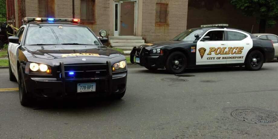Bridgeport Police Department cars at 761 Wood Ave. in Bridgeport, Conn. Tuesday morning, May 24th, 2011. Photo: Ned Gerard / Ned Gerard / Connecticut Post