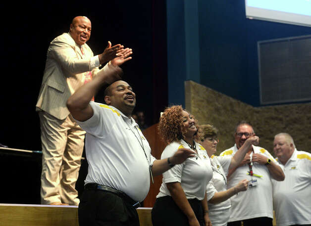 Members of the district's transportation department take part in an interactive motivational moment as guest speaker and veteran teacher Larry Bell offers advice and inspiration for teachers and administrators during a teacher convocation led by Beaumont ISD superintendent John Frossard at West Brook High School Wednesday. The event drew teachers, administrators and other school employees, giving them an introduction to himself and his goals for the new year, as well as techniques for improvement.   Photo taken Wednesday, August 19, 2015  Kim Brent/The Enterprise Photo: Kim Brent / Beaumont Enterprise