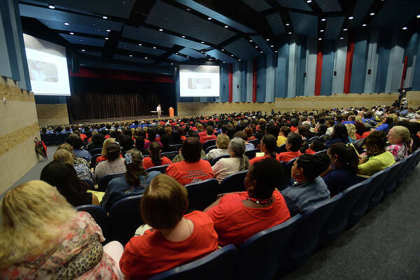 The arts center auditorium is filled during a teacher convocation led by Beaumont ISD superintendent John Frossard at West Brook High School Wednesday. The event drew teachers, administrators and other school employees, giving them an introduction to himself and his goals for the new year, as well as inspirational guest speaker Larry Bell.  Photo taken Wednesday, August 19, 2015 Kim Brent/The Enterprise