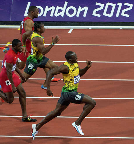 Usain Bolt of Jamaica, leads Justin Gatlin of the USA, Yohan Blake of Jamaica, and Tyson Gay of the USA down the track during the men's 100-meter final at the 2012 London Olympics on Sunday, Aug. 5, 2012. Bolt won gold in the event, with Blake second and Gatlin taking third. ( Smiley N. Pool / Houston Chronicle ) Photo: Smiley N. Pool, Staff / © 2012  Houston Chronicle